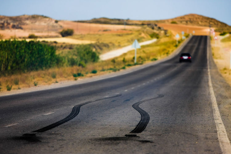 Forward Burnout Countryside Desert Distance Donuts Drift Focus On Foreground Mountain Non-urban Scene Outdoors Power Rearwheeldrive Remote Road Road Marking Rubber Slide SPAIN Speed Street Surface Level TeamCanon The Way Forward Transportation
