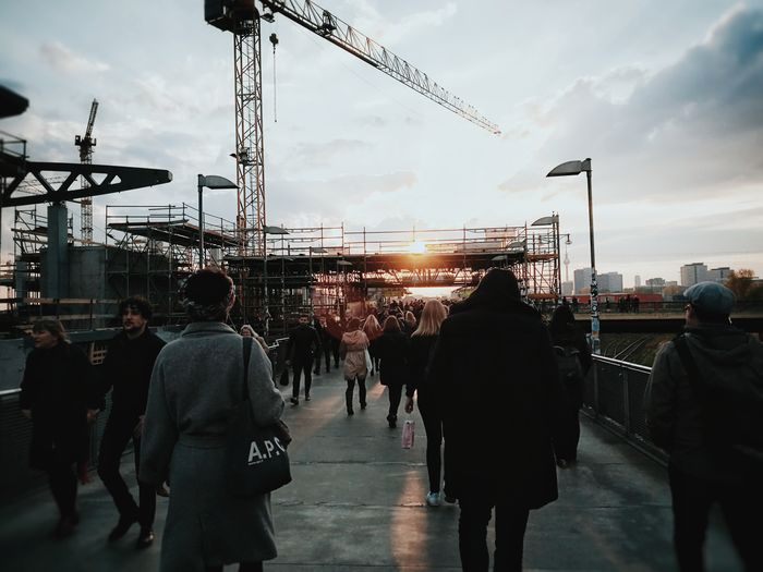 Friday night people... Large Group Of People Market City Sky People Outdoors Crowd Construction Site Streetscene Streetphotography Industrial Architecture Industrial Photography Industrial Building  Machinery Construction Cranes And Construction Cranes Streetphoto_color Sunset Urban Skyline Urban Lifestyle Friday Night The Street Photographer - 2017 EyeEm Awards Neighborhood Map Berlin Love Discover Berlin Colour Your Horizn Go Higher Stories From The City
