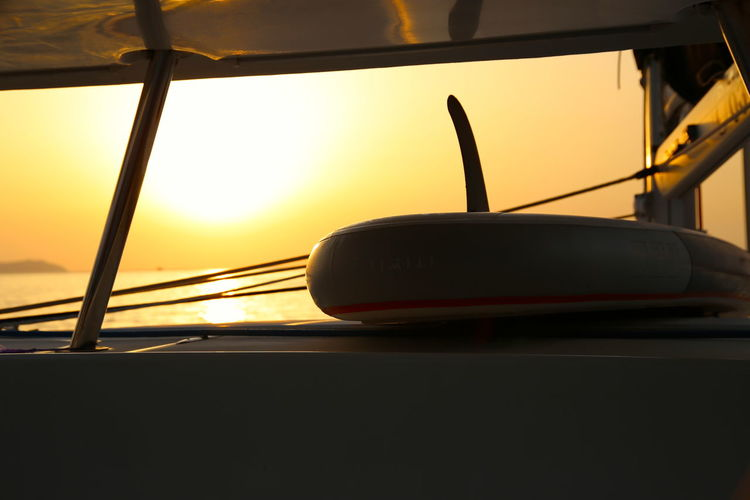 Close-up of car against sky during sunset