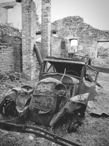 Old car Oradour Sur Glane Ruined Destroyed Bomb Damage Memorial Urban Vintage Rusty Car Vintage Car Rusted Away Corroded Abandoned
