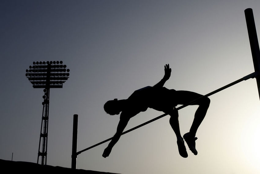 Athlete compete in pole vault Athletes Athletics Body & Fitness Competition Crossbar Jumping Olympics Pole Vault Silhouettes Sports Success Training Vaulting Winner