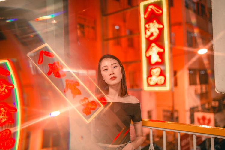 Chinese New Year Travel Photography City Life Portrait Of A Woman Portrait Chinese Chinese New Year Chinese Culture Red Hong Kong HongKong Neon Neon Lights Neon Sign Beauty Only Women Adult Beautiful Woman Portrait Waist Up Beautiful People One Person One Woman Only Lifestyles Night Looking At Camera City Adventures In The City Visual Creativity This Is My Skin
