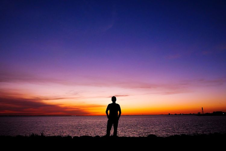 Pele Sky Sunset Water Sea Beach One Person Beauty In Nature Silhouette Standing Scenics - Nature Real People Leisure Activity Lifestyles Tranquil Scene Horizon Over Water Nature Orange Color Tranquility Outdoors Land