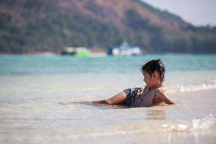 Girl lying in sea