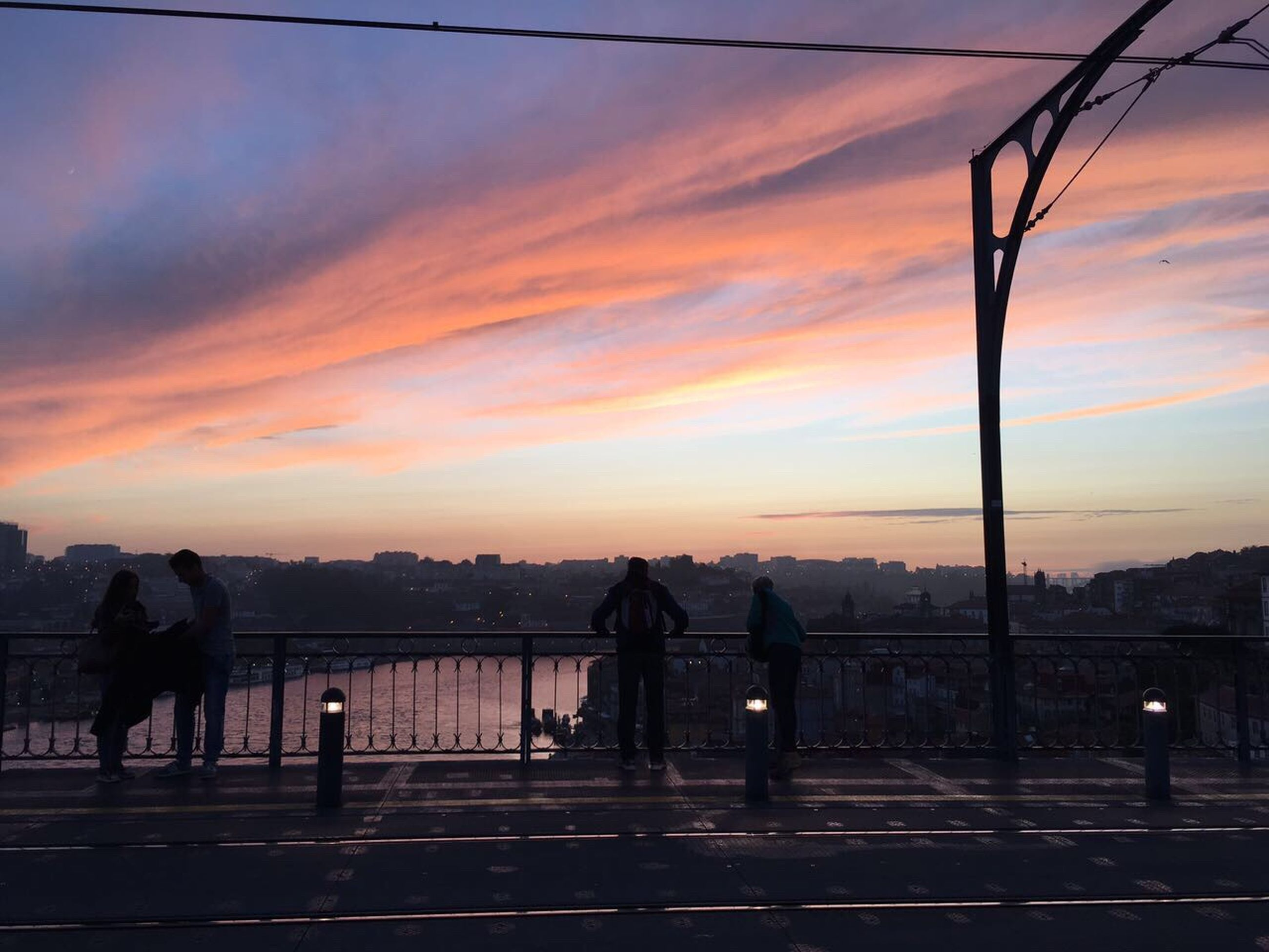 sunset, sky, orange color, real people, cloud - sky, group of people, nature, lifestyles, street, silhouette, men, beauty in nature, leisure activity, standing, outdoors, city, group, people, scenics - nature, transportation