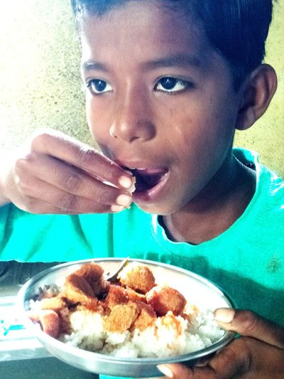Close-up portrait of boy eating food