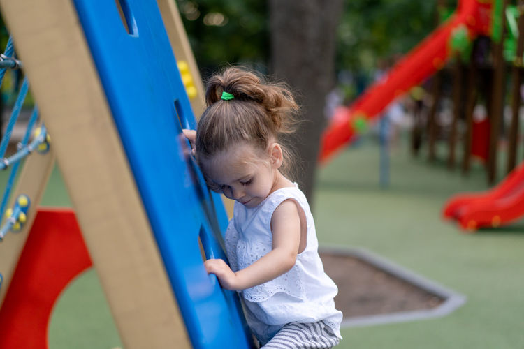 Side view of girl playing on playground