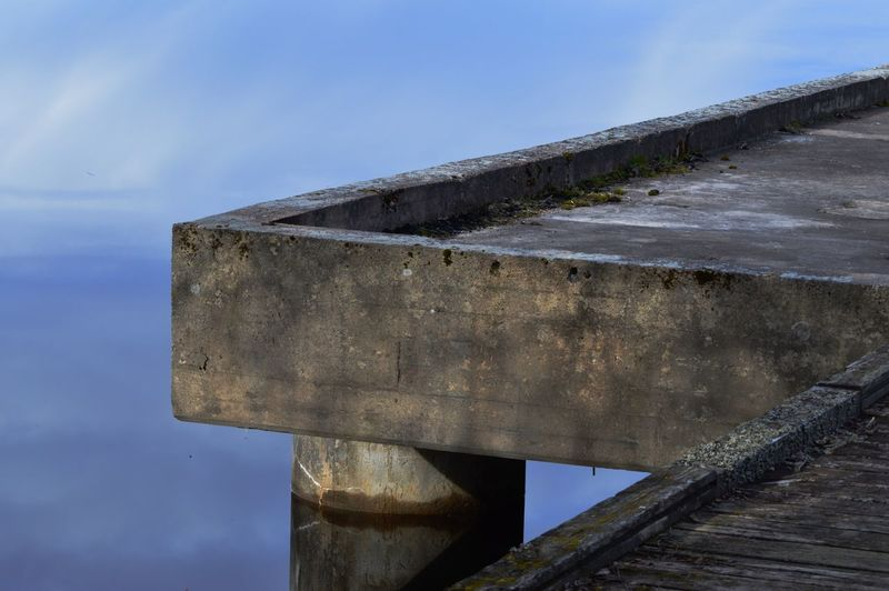 Old abandoned pier Old Abandoned Places Abandoned Sunrise Reflection Brygga Pier Älgsjön Lake Nature No People Day Sky Architecture Water Built Structure Blue Concrete Clear Sky Outdoors Low Angle View Sunlight Wood - Material Close-up