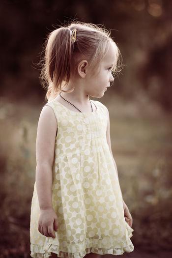 Cute girl looking away outdoors