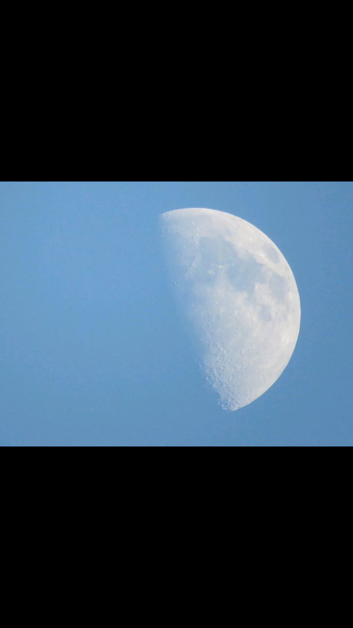 SCENIC VIEW OF MOON AGAINST CLEAR SKY