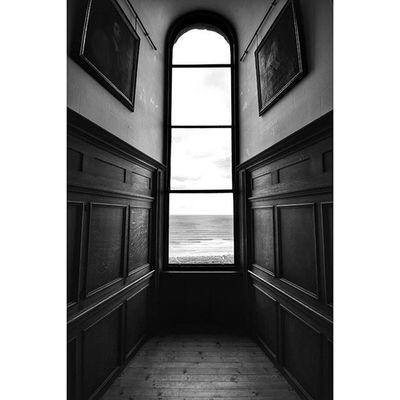 Sea view. Window Rsa_doorsandwindows Bamburghcastle Explorenland Bnw_diamond Bnw_life Bwstyles_gf Blackandwhite Icu_britain_bw Capturingbritain_bnw Jj_sombre Fiftyshadesof_history