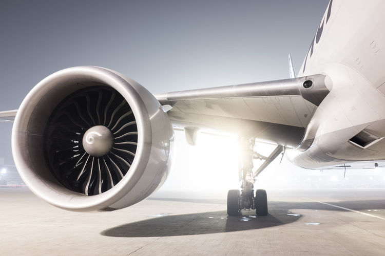 Aerospace Industry Air Vehicle Aircraft Wing Airplane Airport Airport Runway Corporate Jet Day Engine Jet Engine Men Mode Of Transportation Nature Outdoors People Plane Propeller Real People Sunlight Transportation Travel Wheel