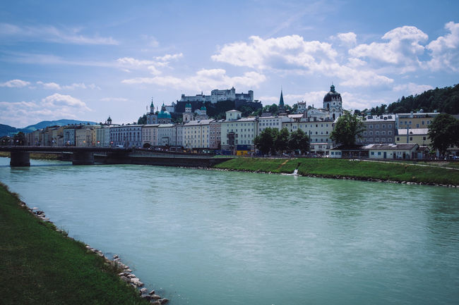 Salzburg, Austria Architecture Bridge - Man Made Structure Building Exterior Built Structure Chain Bridge City Cityscape Cloud - Sky Day History Nature No People Outdoors River Salzburg Sky Tourism Travel Travel Destinations Water Waterfront