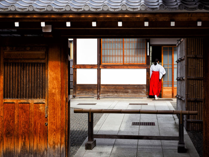 Clothing One Person Architecture Day Traditional Clothing Red Building History Rear View Built Structure Travel Adult Temple Japan The Past Temple Architecture Shinto Shrine Shinto Temple Red Lady Uniform