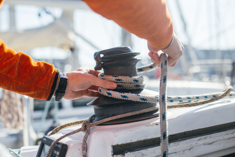 Close-up of man working on boat