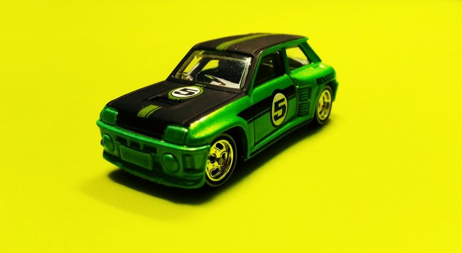 Renault racing Hobbies Collection Hobbies Calsh Of Colors Race Speed Green And Black Colourful EyeEmNewHere Eye Catch Mini Car Mini Cars Studio Shot Still Life Colored Background Toy High Angle View Yellow Background No People Close-up Yellow Green Color Toy Car Childhood