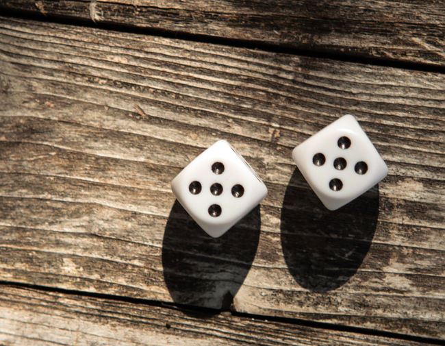 10 Arts Culture And Entertainment Dice Directly Above Gambling High Angle View Leisure Activity Leisure Games Luck Opportunity Pattern Still Life Table Two Objects Wodden Table Wood - Material