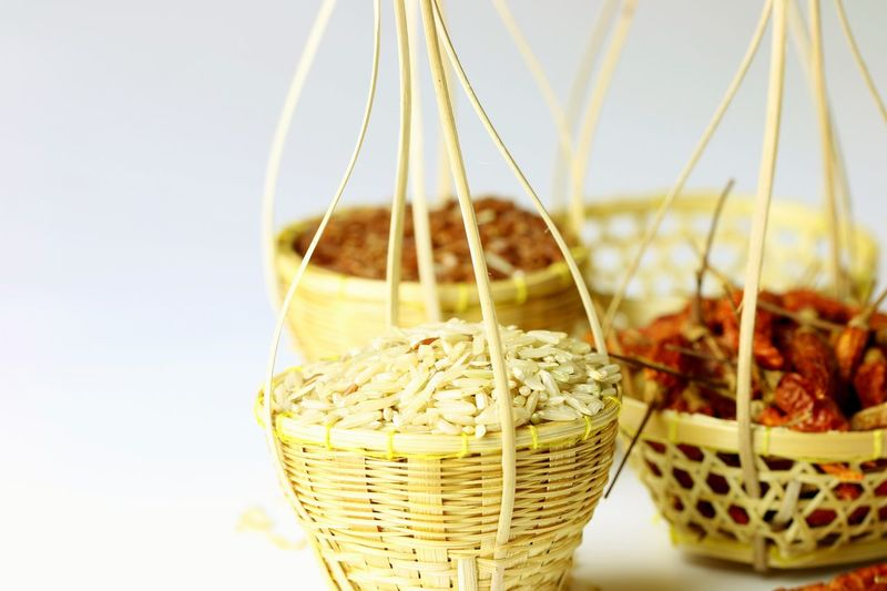 Thai organic farm product in embroidery basket Copy Space Handmade Art Wicker Basket Bamboo - Material Brown Rice Thai Rice Jasmine Rice Basket Food And Drink Food Freshness No People Healthy Eating Close-up