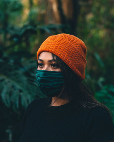 Portrait of young woman in orange hat