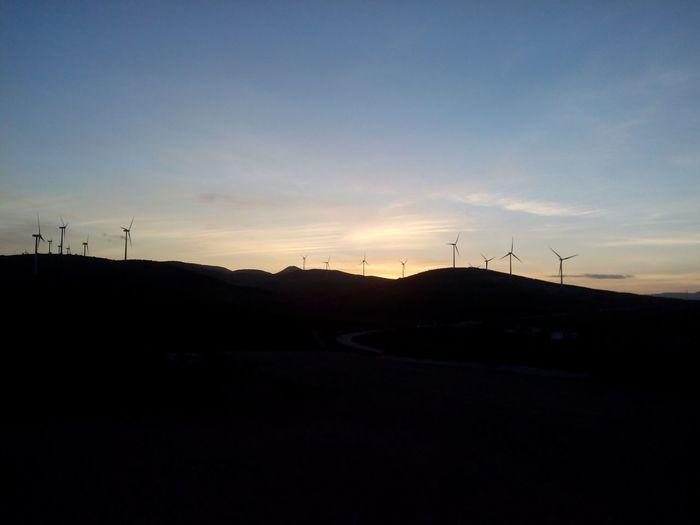 Dusk SPAIN Sunlight Darkness Sky Panorama Wind Turbine Wind Power Tree Windmill Sunset Rural Scene Alternative Energy Technology Fuel And Power Generation Silhouette Dramatic Sky