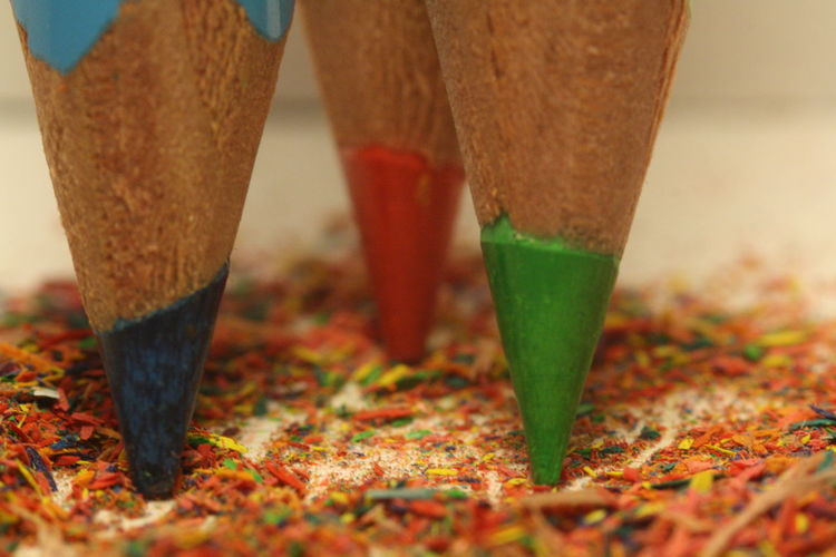 Close-up of colored pencils on shavings