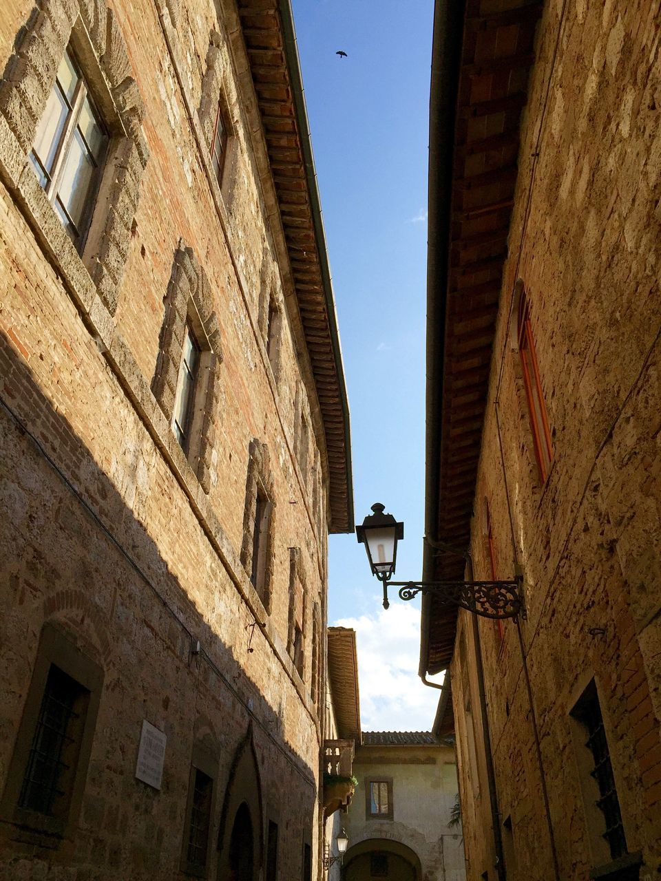 architecture, building exterior, low angle view, built structure, wall lamp, building, street light, window, no people, outdoors, day, sky