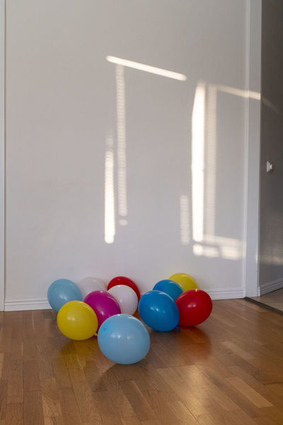 Balloon Celebration Day Decoration Domestic Room Flooring Hardwood Floor Home Interior Indoors  Medium Group Of Objects Multi Colored No People Reflection Still Life Table Wall - Building Feature White Color Wood Wood - Material