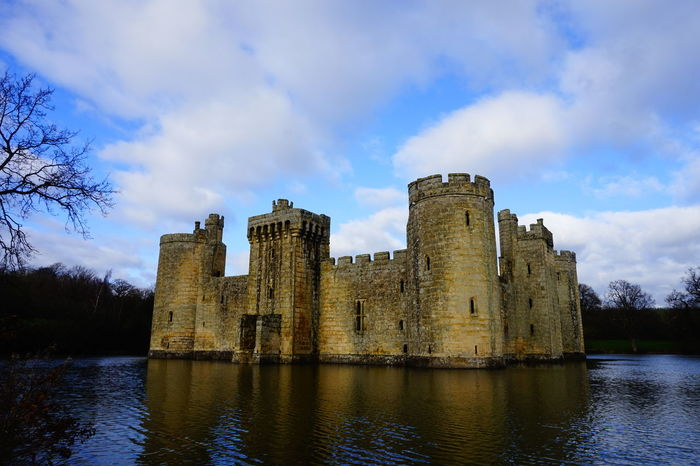 Bodiam Castle Ancient Architecture Blue Sky Bodiam Castle Building Exterior Built Structure Castle Clouds Historic Historical Building Historical Buildings Historical Sights History Medieval Medieval Architecture Moat Old Old Ruin Outdoors Ruined Sky And Clouds The Past