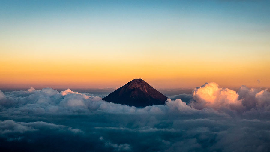 Amazing landscape view of Guatemala mountain at sunset. Aerial view of outdoor scene of morning sunrise during trekking activity. Mountain peak with clouds background. Travel and adventure concept Guatemala Lifestyle Moment Nature Panorama Sunset_collection Travel Beauty In Nature Blue Blue Sky Cloud - Sky Clouds And Sky Day Landscape Mountain Nature No People Outdoors Scenics Sky Sunset Tranquil Scene Tranquility Volcano World