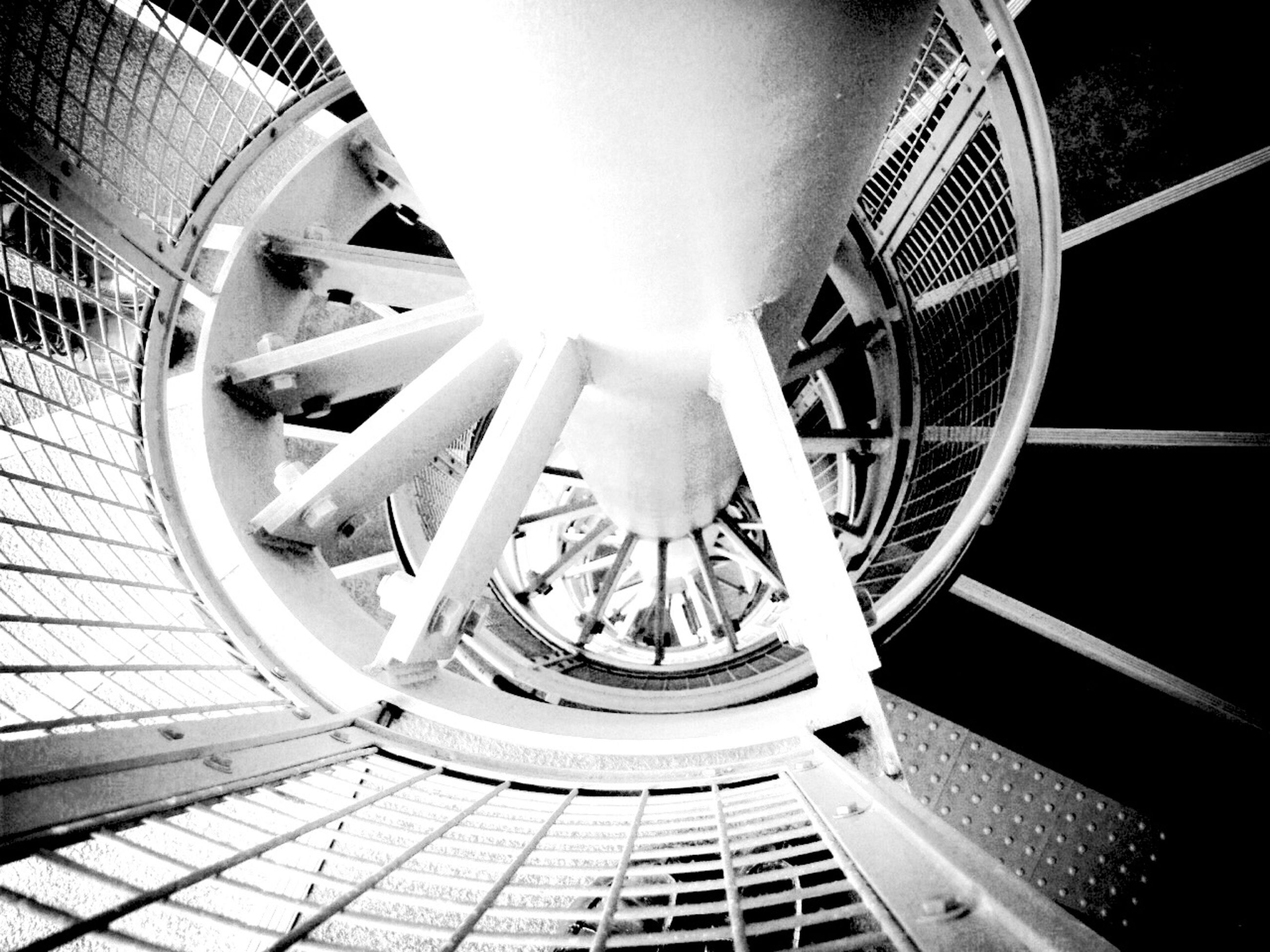 built structure, architecture, low angle view, staircase, steps, steps and staircases, railing, spiral staircase, indoors, metal, no people, wheel, spiral, travel, architectural feature, building exterior, day, transportation, part of, building
