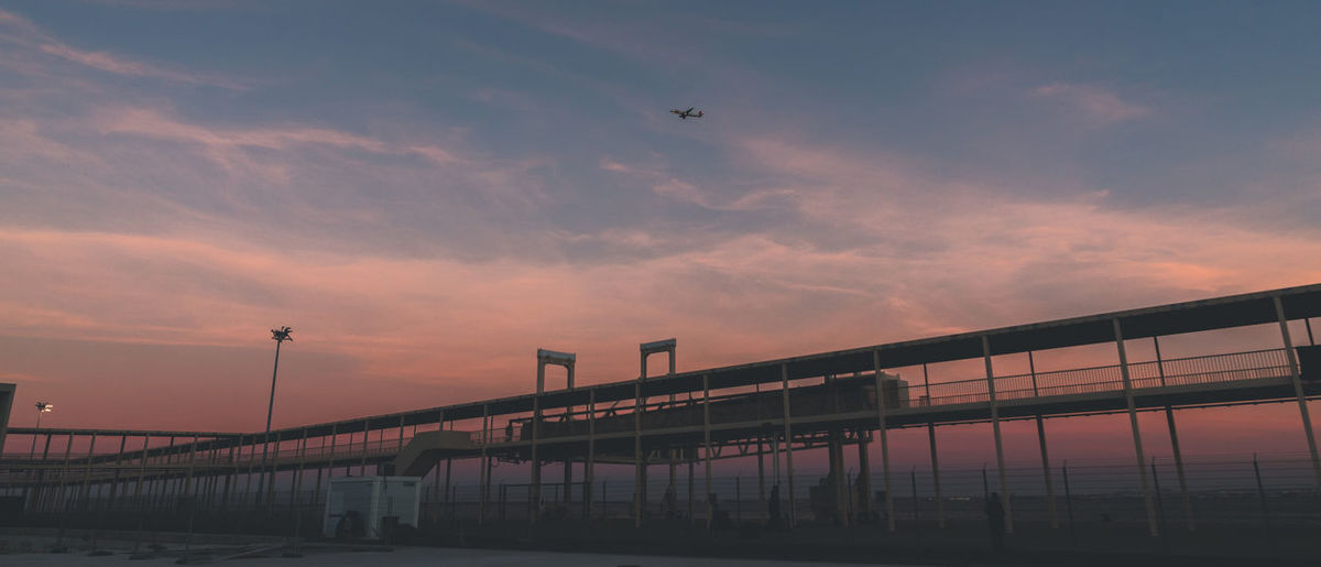Air Vehicle Airplane Architecture Beauty In Nature Bridge Bridge - Man Made Structure Built Structure Cloud - Sky Connection Flying Low Angle View Mode Of Transportation Nature No People Outdoors Public Transportation Sky Sunset Transportation Water