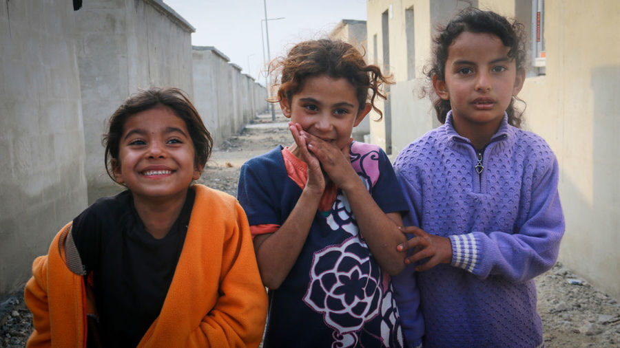 Portrait of kids standing outdoors