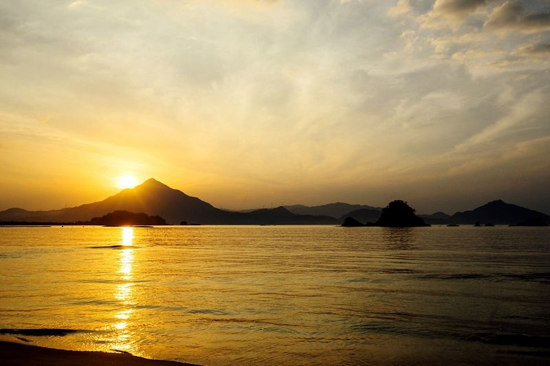 Golden Water Sunset Silhouettes Sunset Beauty In Nature Evening Sky Water Reflections Reflection Cloud - Sky Japan Photography September September 2016 Sand Landscape Beach Seaside Mountain Silhouette Silhouette Sunbeam Japan Sea Time Is Running Out