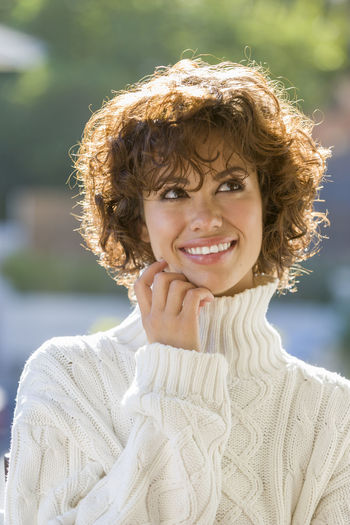 Close-Up Of Smiling Woman Wearing Sweater