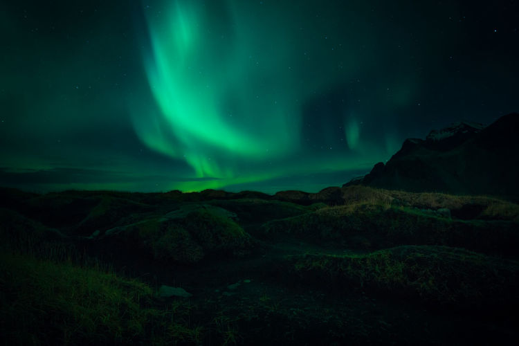 Northern Lights in Iceland Tranquility Mountain Landscape Idyllic Aurora Polaris Tranquil Scene Environment Space Star - Space Scenics - Nature Sky Night Green Color Beauty In Nature Illuminated Non-urban Scene Astronomy No People Nature Cloud - Sky Northern Lights Northern Lights Iceland Nightphotography Explore