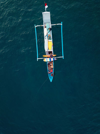 High angle view of man floating on sea