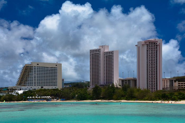 Northern Mariana Islands Northern Marianas Islands Architecture Beach Building Building Exterior Built Structure City Cloud - Sky Day Guam Luxury Nature No People Office Building Exterior Outdoors Plant Residential District Sea Sky Skyscraper Swimming Pool Travel Destinations Tree Water Waterfront