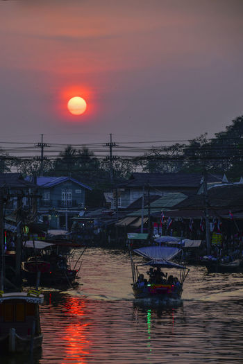 Fishing boats in river at sunset