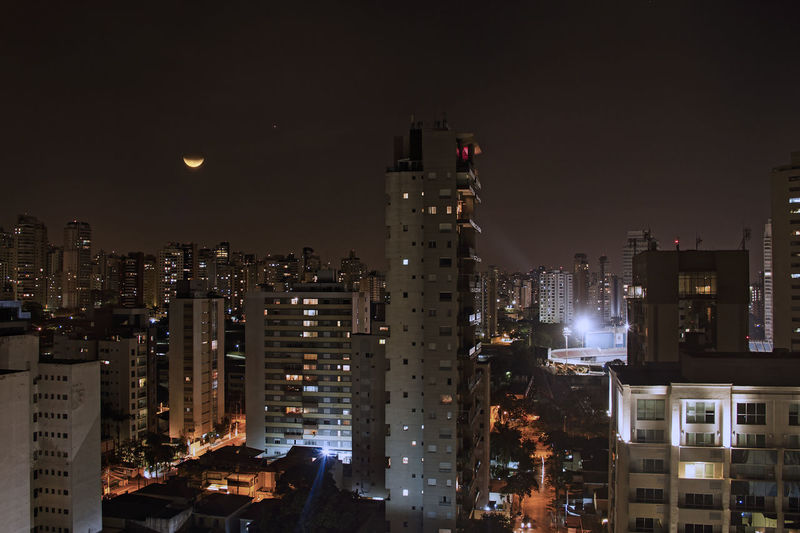 lunar Eclipse in São Paulo Lunar Eclipse Moon Sao Paulo - Brazil Apartment Architecture Building Building Exterior Built Structure City City Life Cityscape Eclipse Financial District  Illuminated Modern Nature Night No People Office Building Exterior Outdoors Residential District Sky Skyscraper Tall - High Tower