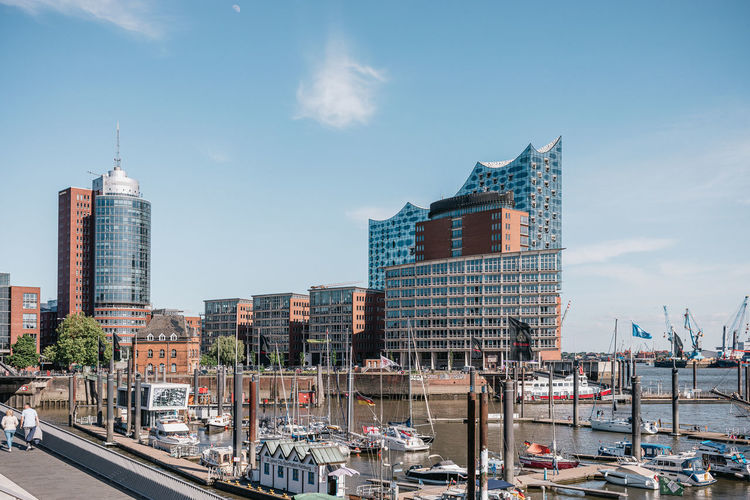 Modern buildings in city against sky at hamburg harbour