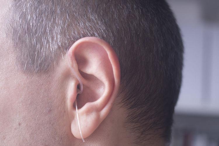 Close-up of man wearing hearing aid