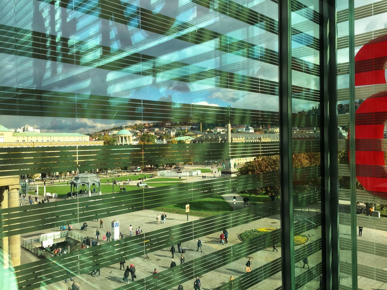 architecture, glass - material, transparent, built structure, window, city, building exterior, transportation, incidental people, day, outdoors, mode of transportation, reflection, group of people, modern, travel, nature, airport, building