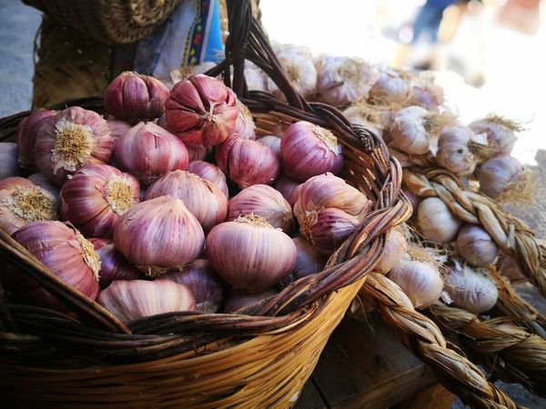 Garlic Garlic Bulb Food Vegetable Food And Drink Healthy Eating Freshness No People Day Outdoors Close-up Red Violet Porfume EyeEmBestPics EyeEm Best Shots Market P9 Huawei EyeEm EyeEm Gallery Multi Colored Freshness