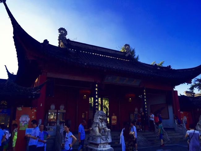 Nanking Built Structure Large Group Of People Architecture Building Exterior Religion Statue Travel Destinations Place Of Worship Sculpture Real People Eaves Outdoors Low Angle View Day Women Men Roof Sky Clear Sky