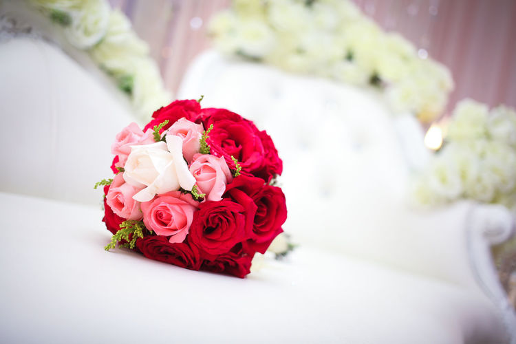 Rose Bouquet On Table At Wedding Ceremony