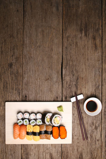 Assorted sushi mix on wooden surface Sushi Food And Drink Rice Food Japanese Food Freshness Japan AssoRted Variety Fresh Seafood Meal Cuisine Chopsticks Wood Wooden