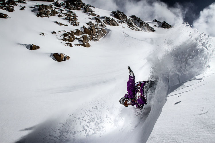 Low Angle View Of Snowboarder On Mountain