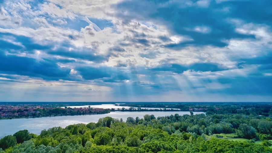 Italy, Mantua: historical city of Mantua surrounded by 3 lakes Drone  Drone Photography Mavic 2 Pro Mavic Rays Of Light Lake UNESCO World Heritage Site Unesco World Heritage Unesco Sun Rays Cloudy Cloud - Sky Forest Outdoors Landscape Scenics Horizon Over Land From A Distance From Above  Reflection Mantova Mantua Italy Sky Beauty In Nature Scenics - Nature Water Tranquility Plant Tranquil Scene Sea Nature Day No People Tree Horizon Green Color Idyllic Land Horizon Over Water Nobody