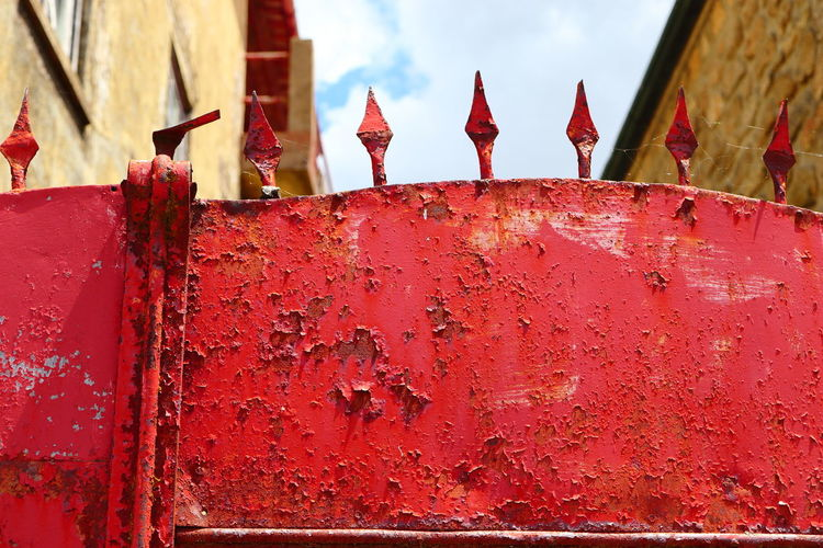 Close-up of red bell against wall