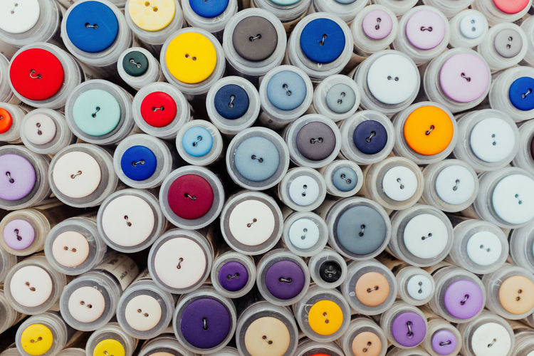 Buttons Multi Colored Large Group Of Objects Choice Variation Still Life Full Frame Backgrounds No People Indoors  Abundance Button Collection Sewing DIY Homemade Arrangement Sewing Item Thread Spool Stack Close-up Textile Shape Order